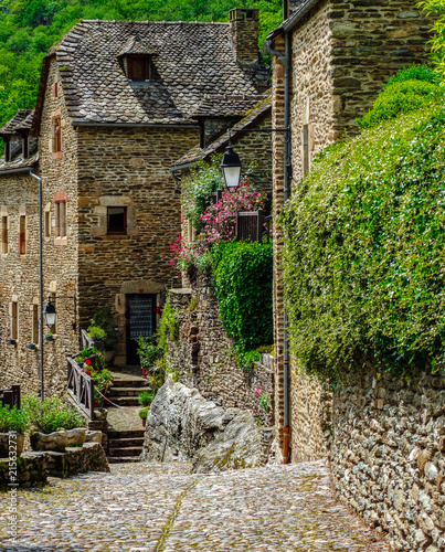 Sunny road in the medieval village of Belcastel, France Canvas Print