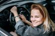 beautiful young girl driver smiling.