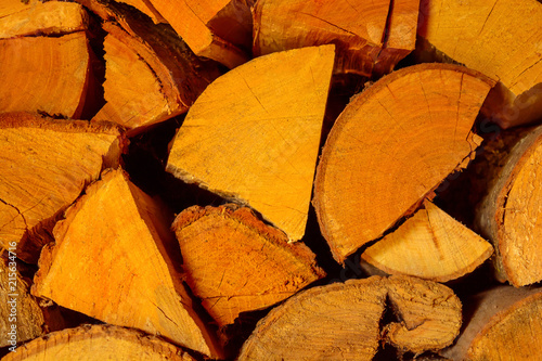 Photo of chopped firewood texture in warm tone