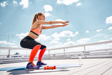 Sporty Woman Is Doing Squats O...