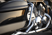 Close Up View Of A Shiny Chrome Motorcycle Design Engine With Exhaust Pipes