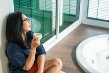 Casual Asian Woman Relaxing An...