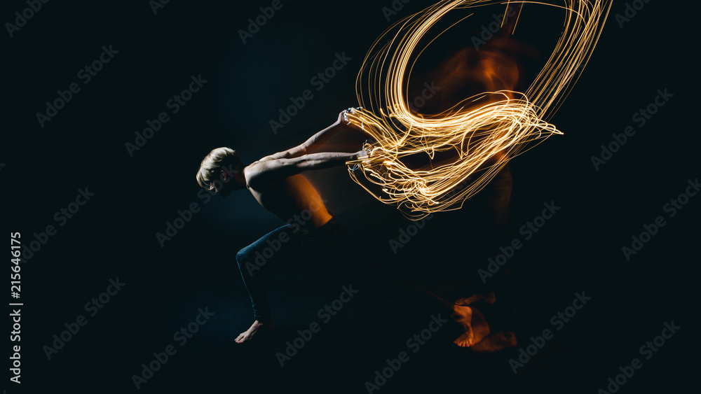Fototapety, obrazy: metaphor naked man resistance to battle with problems and depression. Drawing with light. Long exposure creative emotional portrait. Dark background