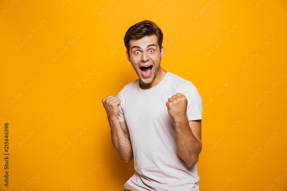 Fototapety, obrazy: Portrait of an astonished young man celebrating success