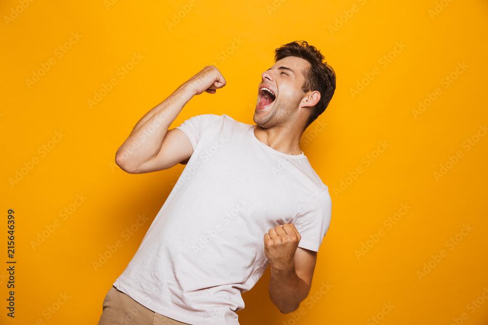 Fototapeta Portrait of a joyful young man celebrating