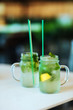 Lemonade from lime with mint, mohito, with ice, glass jar, mason jar.