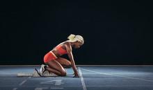 Woman Sprinter Using A Startin...