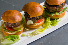 Close Up Shot Of 3 Sliders On A Plate
