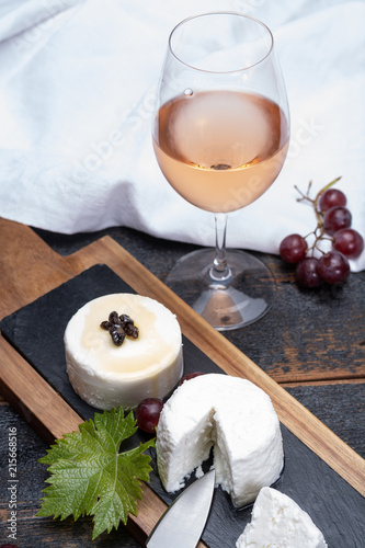 Foto op Aluminium Buffet, Bar French soft cheeses, variety of different taste goat milk natural cheeses on granite plate close up sesrved as dessert with cold rose wine from Provence