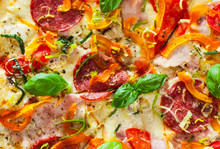 Pizza With Mozzarella Cheese, Ham, Tomatoes, Salami, Pepper, Pepperoni Spices And Fresh Basil. Italian Pizza.  Close Up.