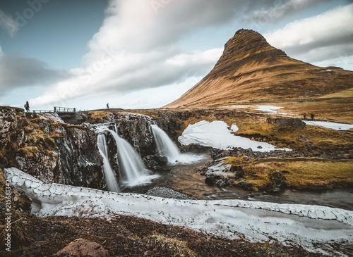 Fotobehang Grijze traf. Kirkjufellsfoss and Kirkjufell Icelandic, Church mountain , a 463 m high mountain on the north coast of Iceland's Snaefellsnes peninsula, near the town of Grundarfjordur, Iceland