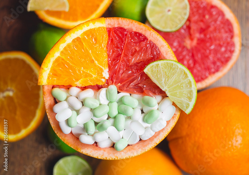 Fotografie, Obraz  Vitamin C in citruses and supplement. Concept