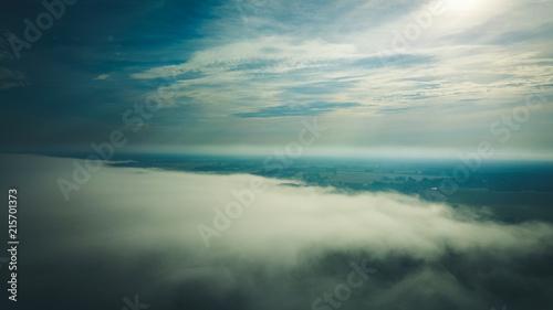 Fototapeta Misty sunrise over countryside path Aerial view Latvia obraz na płótnie