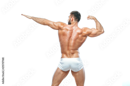 bodybuilder posing. Beautiful sporty guy male power. Fitness muscled manin white lingerie. on isolated white background.