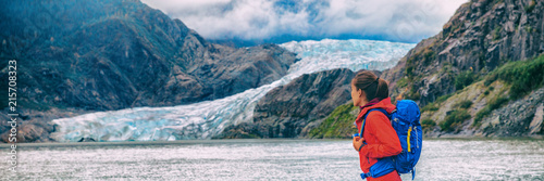 obraz PCV Alaska glacier travel destination Mendenhall tourist attraction in Juneau, USA. Woman walking at ice landscape background panoramic.