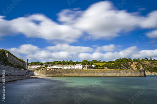 The beautiful summer sun bathes the coastline of Charlestown Harbour Canvas Print