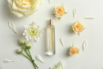 Beautiful composition with bottle of perfume on white background, flat lay
