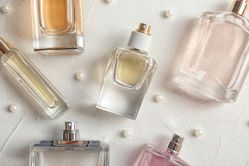 Beautiful composition with bottles of perfume on white background, flat lay