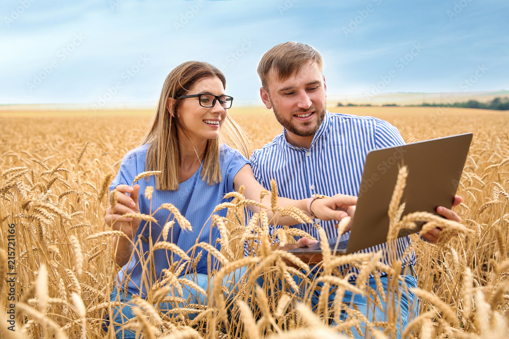 Fototapety, obrazy: Young agronomists in grain field. Cereal farming