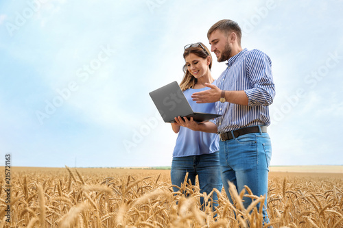 Young agronomists in grain field. Cereal farming Canvas Print