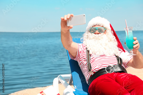 obraz PCV Authentic Santa Claus taking selfie at resort