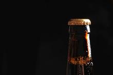 Bottle Of Tasty Cold Beer On Black Background, Closeup
