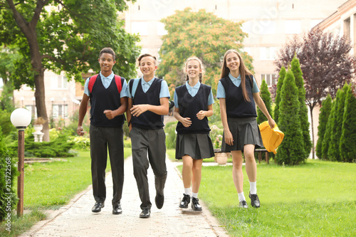 Teenage students in stylish school uniform outdoors Fototapete