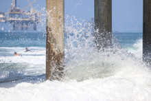 Waves Crashing On A Pier Pilin...