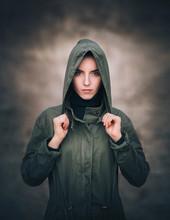 A Girl In A Raincoat Put A Hoo...