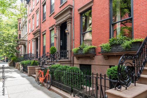 Photo  Two bicycles in front of a brownstone building in neighborhood of Brooklyn Heigh