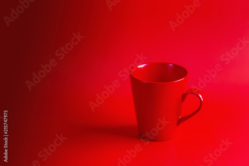 Red coffee cup on a red background