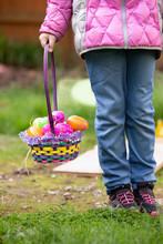 Child Holding Basket Filled Wi...