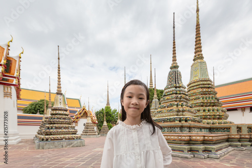Fotobehang Bangkok Cute happy smiling tourist girl at Wat Phra Chetuphon or Wat Pho is a Buddhist temple in the city of Bangkok,Thailand, summer vacation,travel concept.