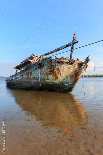 Foto op Aluminium Schipbreuk Broken and old fishing boat , Three Ship Wreck in Kuala Penyu, Sabah, Malaysia , Abandoned Ship at sabah borneo malaysia Image has grain or blurry or noise and soft focus when view at full resolution.