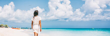 Luxury Beach Vacation Travel Woman Relaxing On Paradise Tropical Holiday Destination For Sun Getaway. Girl Wearing Beach Dress Walking Panoramic Banner.