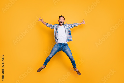 Fotografie, Obraz  Full-legh portrait of of crazy and excited handsome man jumping up like a star i