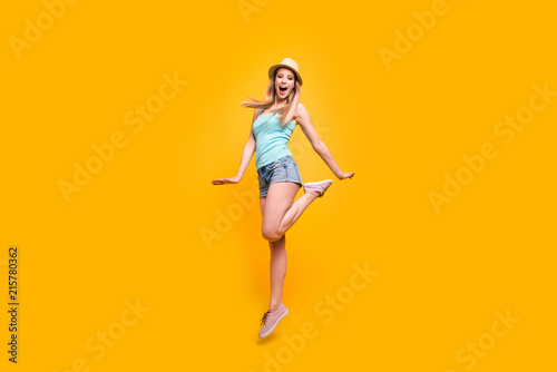 Fototapety, obrazy: Full-size portrait of lovely girl in headwear jump and fun isolated on shine yellow background with space for text