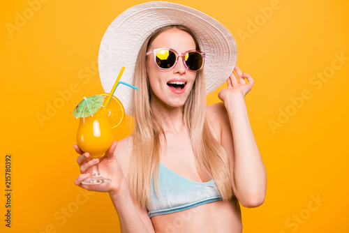 Fotografie, Obraz  Attractive nice cute straight-haired beautiful blonde caucasian smiling girl, wearing blue swimsuit, sun glasses, hat