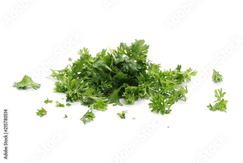 Fresh green chopped parsley leaves isolated on white background