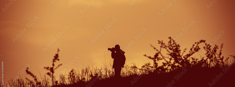 Fototapety, obrazy: photographer takes pictures in the wild. Web banner.