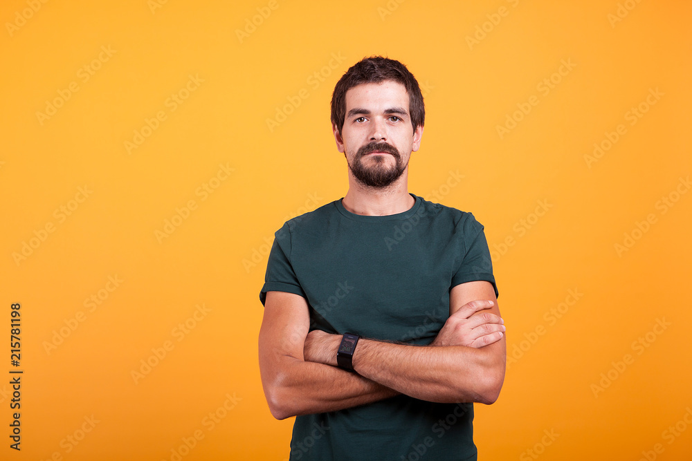 Fototapety, obrazy: Serious man isolated on orange background. Confident person looking in the camera
