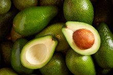Bunch Of Fresh Avocados In The Organic Food Market
