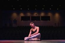 Ballet Dancer Wearing Ballet Shoe On Stage