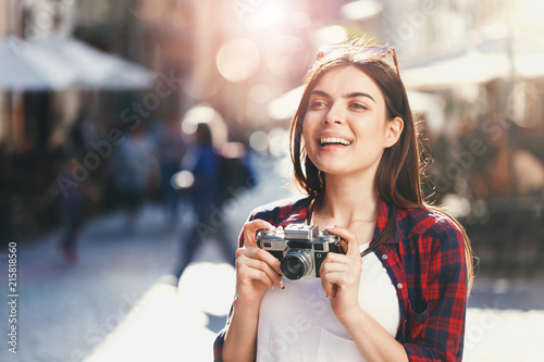 Fotografia  Portrait of young stylish hipster romantic long-hair girl in sunglasses staying