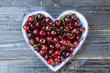 Fresh Sweet Cherry In A Heart-shaped Plate