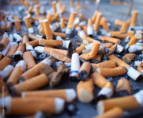 Cigarette butts, concept of dangerous and health harmful smoker lifestyle Fototapeta