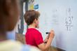 canvas print picture Boy solving math problem