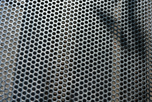 Türaufkleber Metall Metal mesh, background, with round identical holes, metal structure with shadow and light
