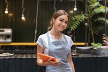 Beautiful Waitress. Beautiful Waitress Wearing Her Uniform Feeling Good While Welcoming Guests Of Restaurant