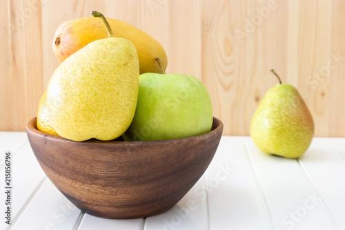 Foto op Aluminium Vruchten Fruit, apple, pear, mango in wooden bowl. Concept Autumn harvest.